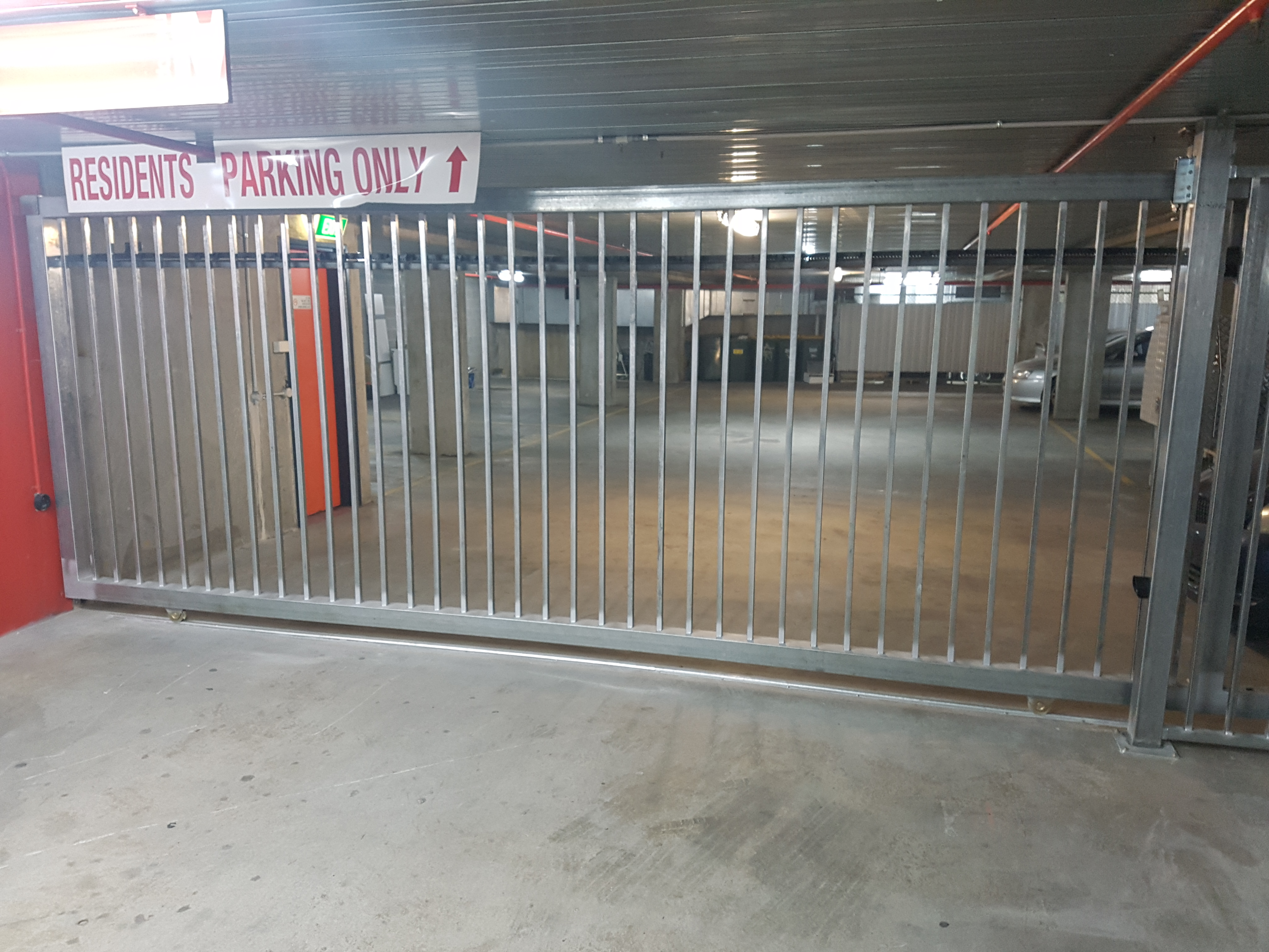 La bayside gates and garage doors new gate install in st for Bayside garage doors