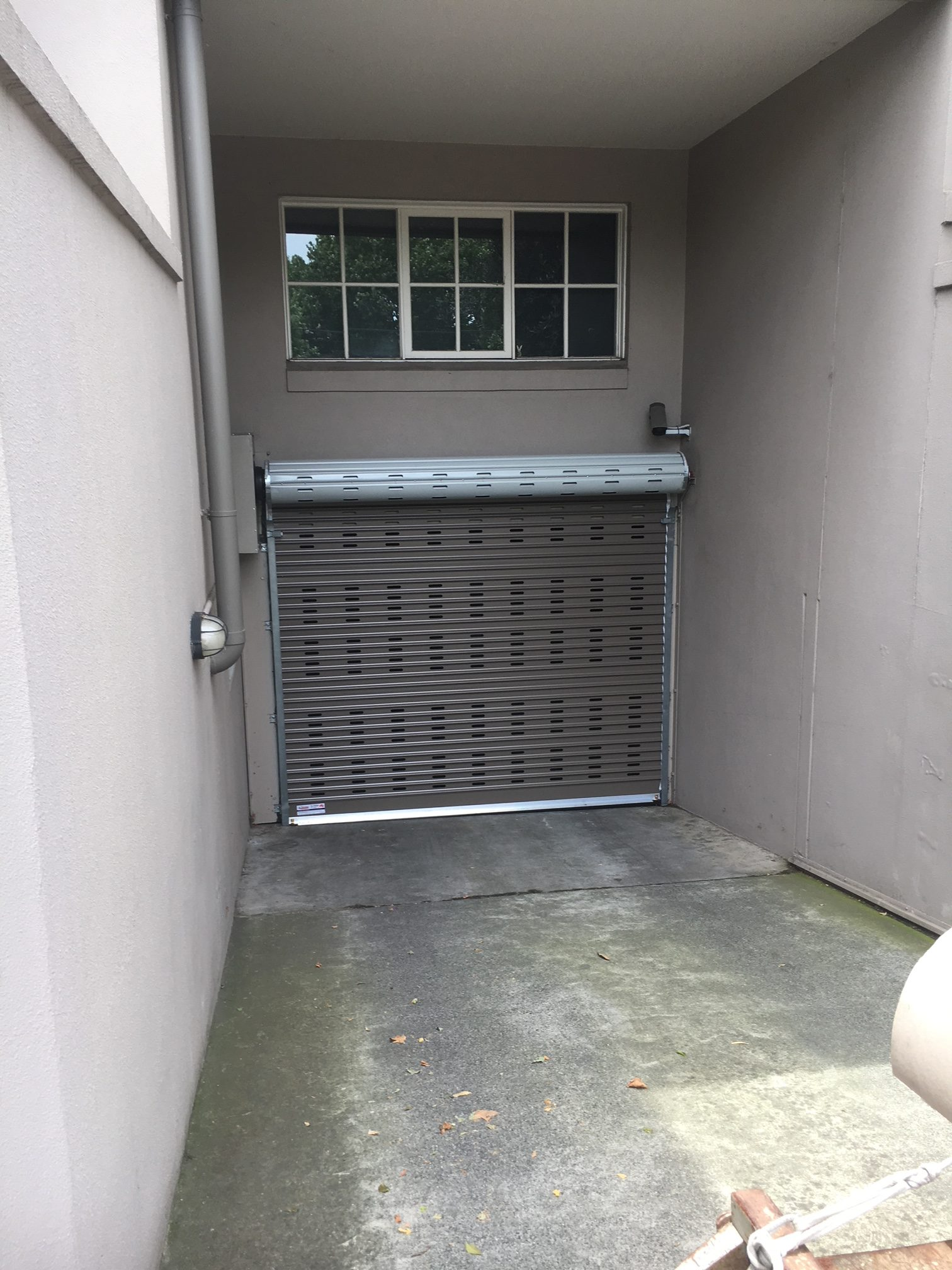 La bayside gates and garage doors perforated roller door install on apartment building in windsor